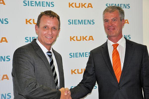 Robert Neuhauser (Siemens, links) en Manfred Gundel (Kuka) willen de samenwerking tussen beide concerns intensiveren.